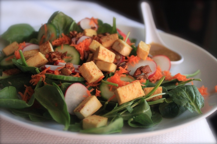 Spinach, Tofu and Shaved Carrot Salad with Sesame Dressing and Spice Pepita & Cashew Crunch